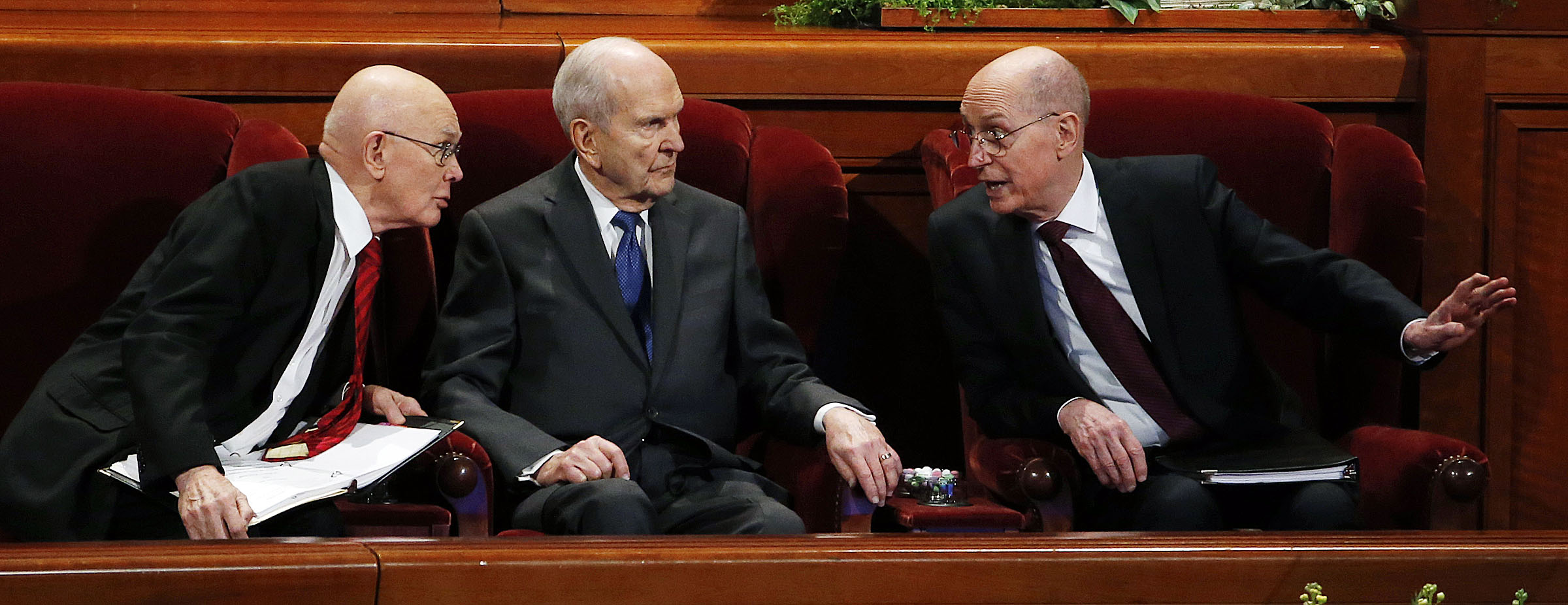 LDS Church President Russell M. Nelson, center, and his counselors, President Dallin H. Oaks, first counselor in the First Presidency, left, and President Henry B. Eyring, second counselor in the First Presidency, right, confer at the beginning of the Saturday afternoon session of the 188th Annual General Conference in Salt Lake City on Saturday, March 31, 2018.
