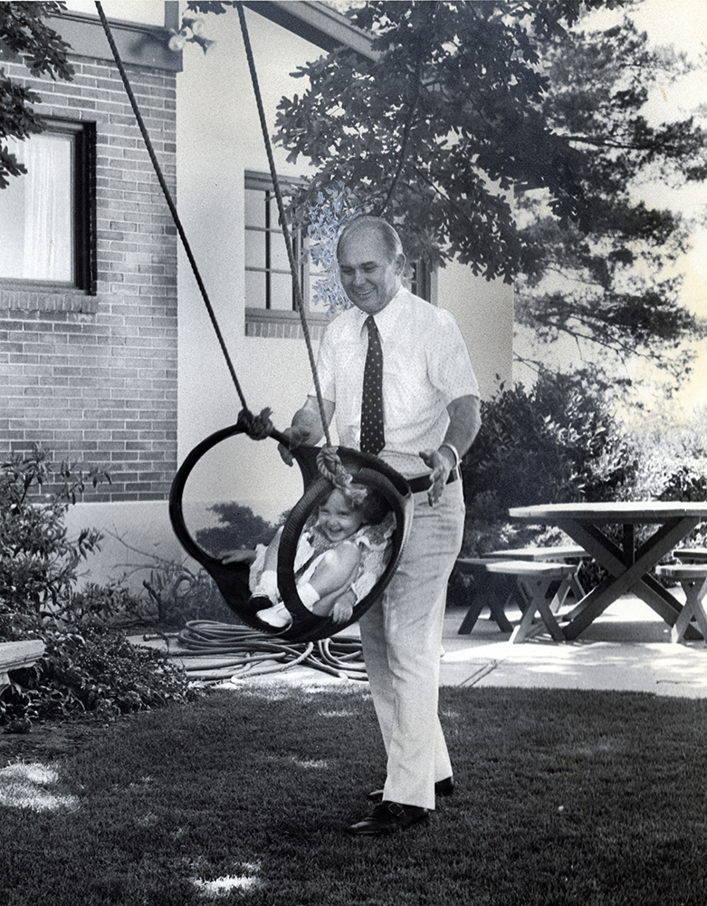 BYU President Dallin H. Oaks doesn't have a lot of spare time, but what he does have he spends with his family. Here, he pushes youngest daughter, Jenny, in backyard swing.