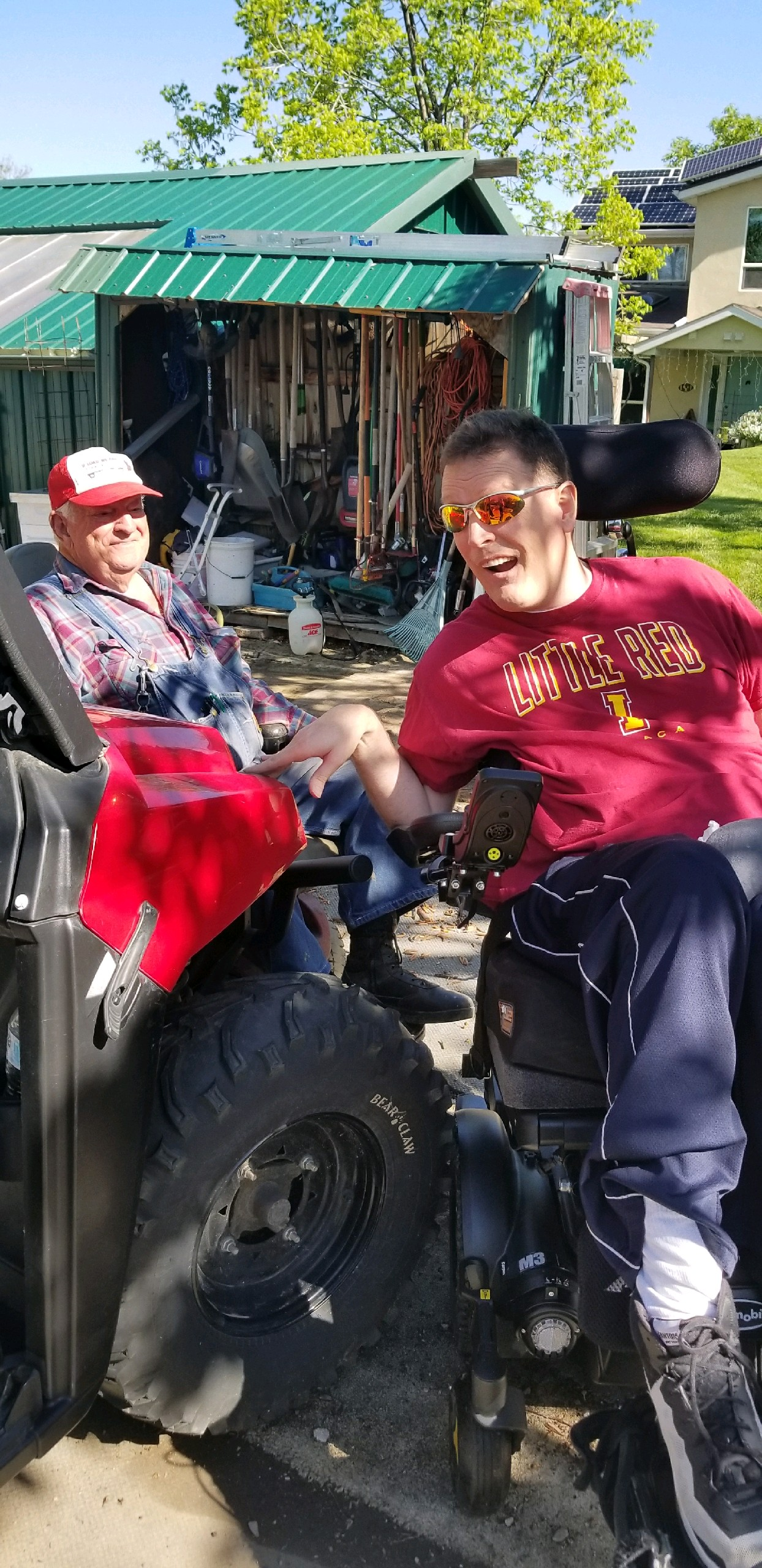 Orin Voorheis and his father like to go for rides in a Polaris. More than 20 years after being shot in the head on his mission, Voorheis is living a happy life surrounded by family and friends.
