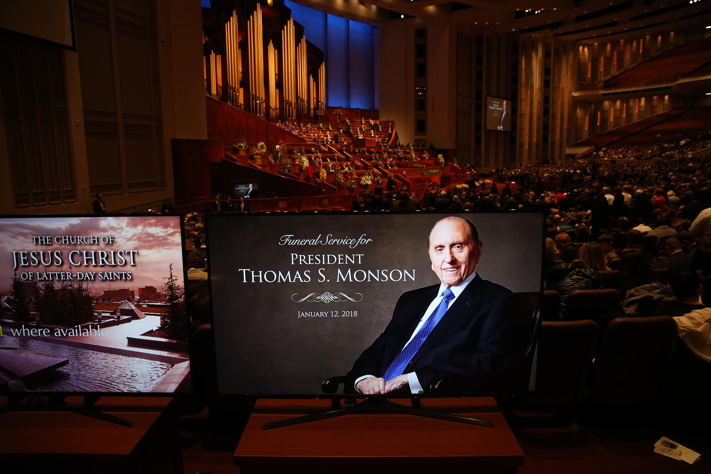 Mourners wait for Church President Thomas S. Monson's funeral to begin at the Conference Center in Salt Lake City on Friday, Jan. 12, 2018.