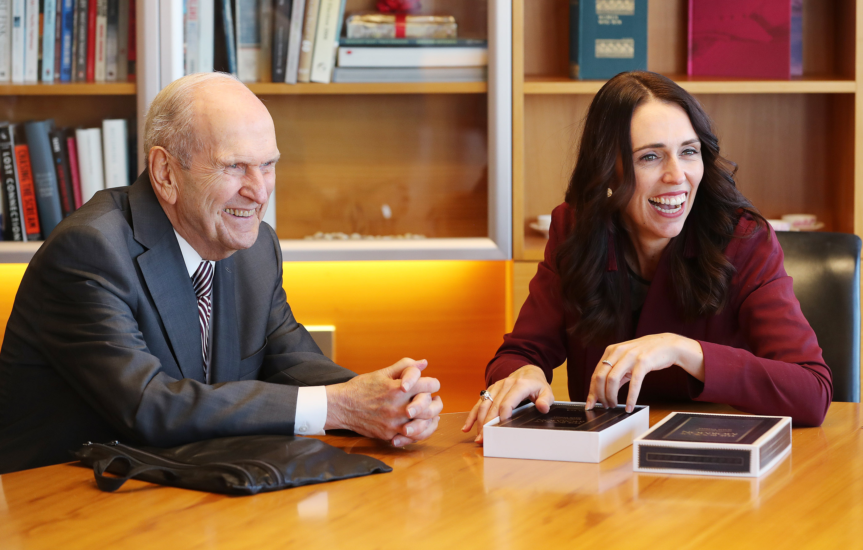 President Russell M. Nelson of The Church of Jesus Christ of Latter-day Saints gives a Book of Mormon to New Zealand Prime Minister Jacinda Ardern in Wellington, New Zealand, on Monday, May 20, 2019.