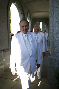 President Thomas S. Monson, followed by Elder L. Tom Perry, walks to the site for the sealing of Sacramento temple's symbolic cornerstone.
