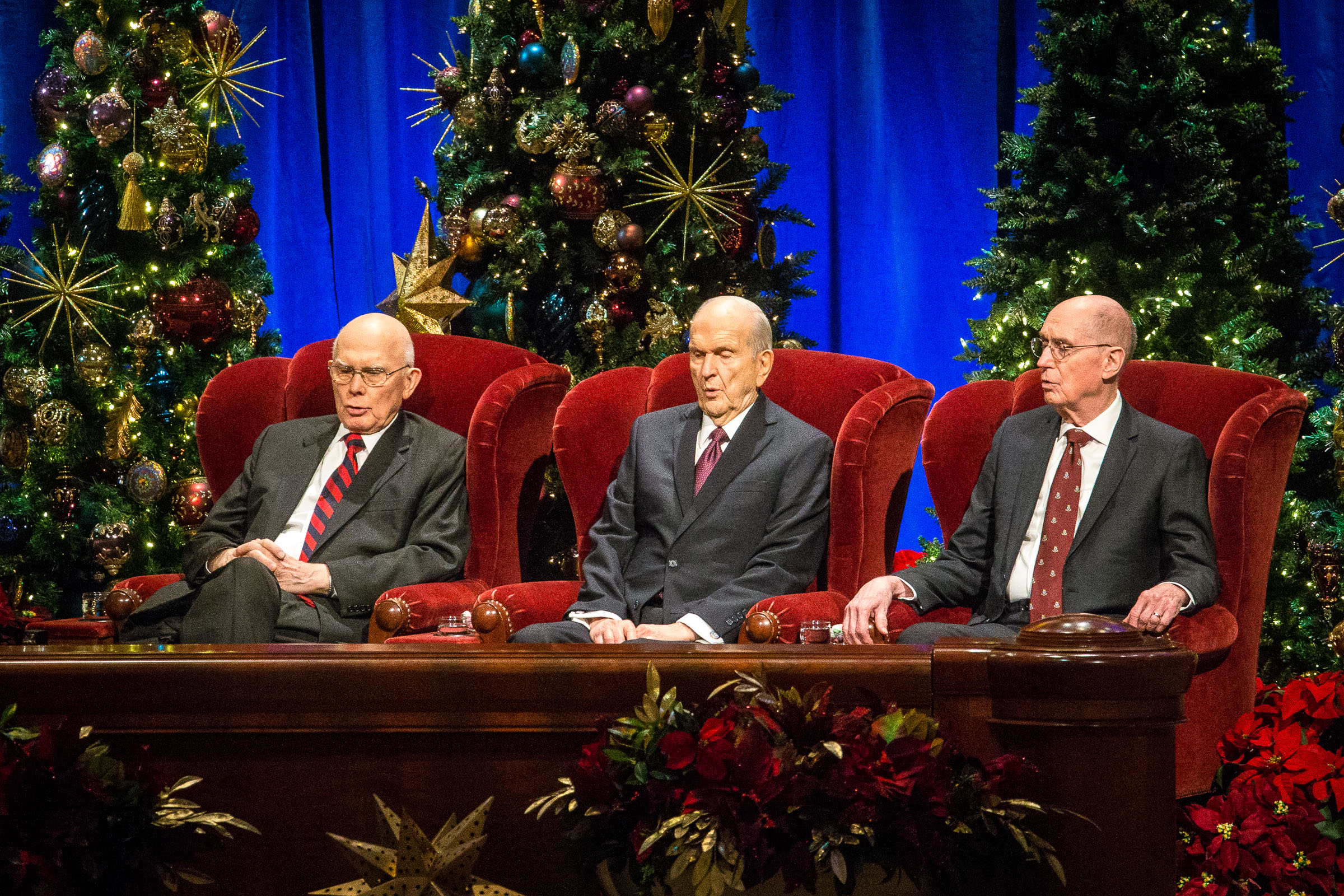 President Dallin H. Oaks, first counselor in the First Presidency, left, President Russell M. Nelson, and President Henry B. Eyring, second counselor in the First Presidency, sing along with the Tabernacle Choir during the First Presidency's Christmas Devotional in the Conference Center in Salt Lake City on Sunday, Dec. 2, 2018.