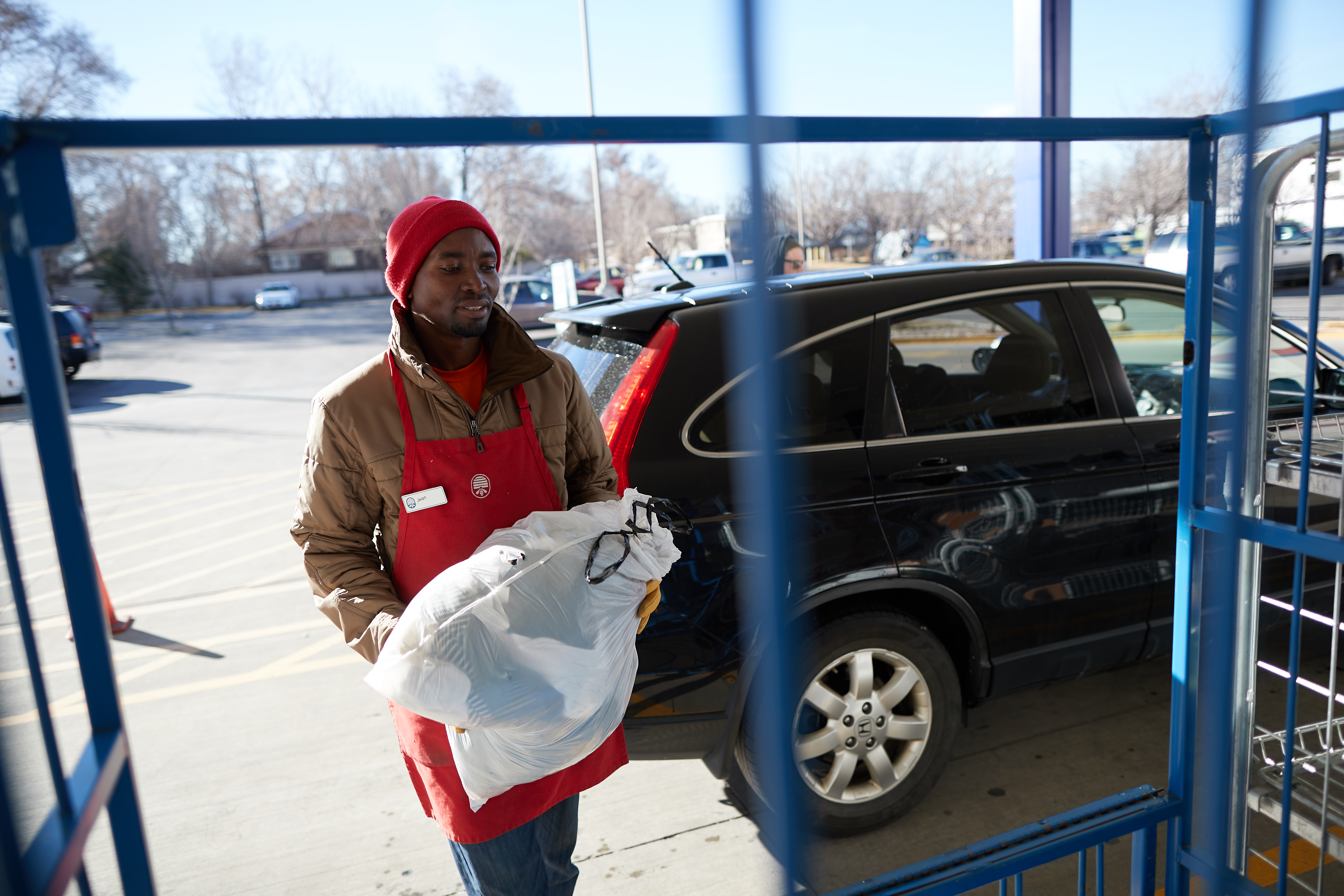 Jean Niyonzima accepts a donation outside a Deseret Industries store.