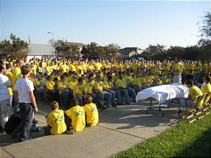 Volunteers wearing Mormon Helping Hands shirts attend sacrament meeting during clean-up efforts after Hurricane Ike.