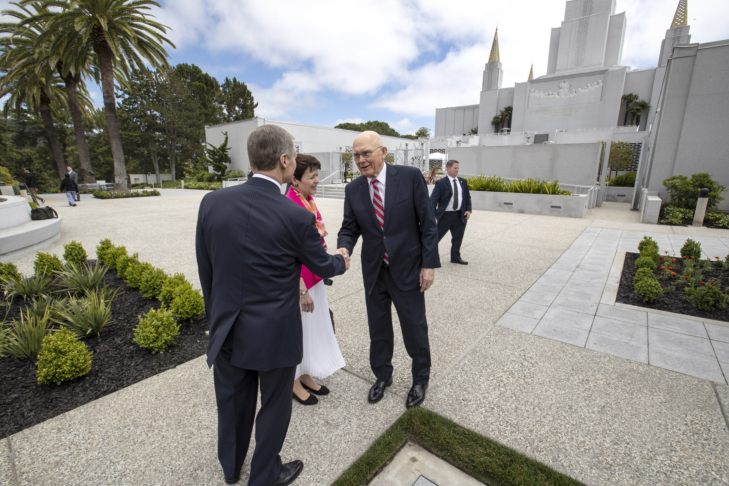 President Dallin H. Oaks, first counselor in the First Presidency, right, greets Elder David A. Bednar of the Quorum of the Twelve Apostles and his wife, Sister Susan Bednar as they prepare to walk-through the Oakland California Temple on Saturday, June 15, 2019.