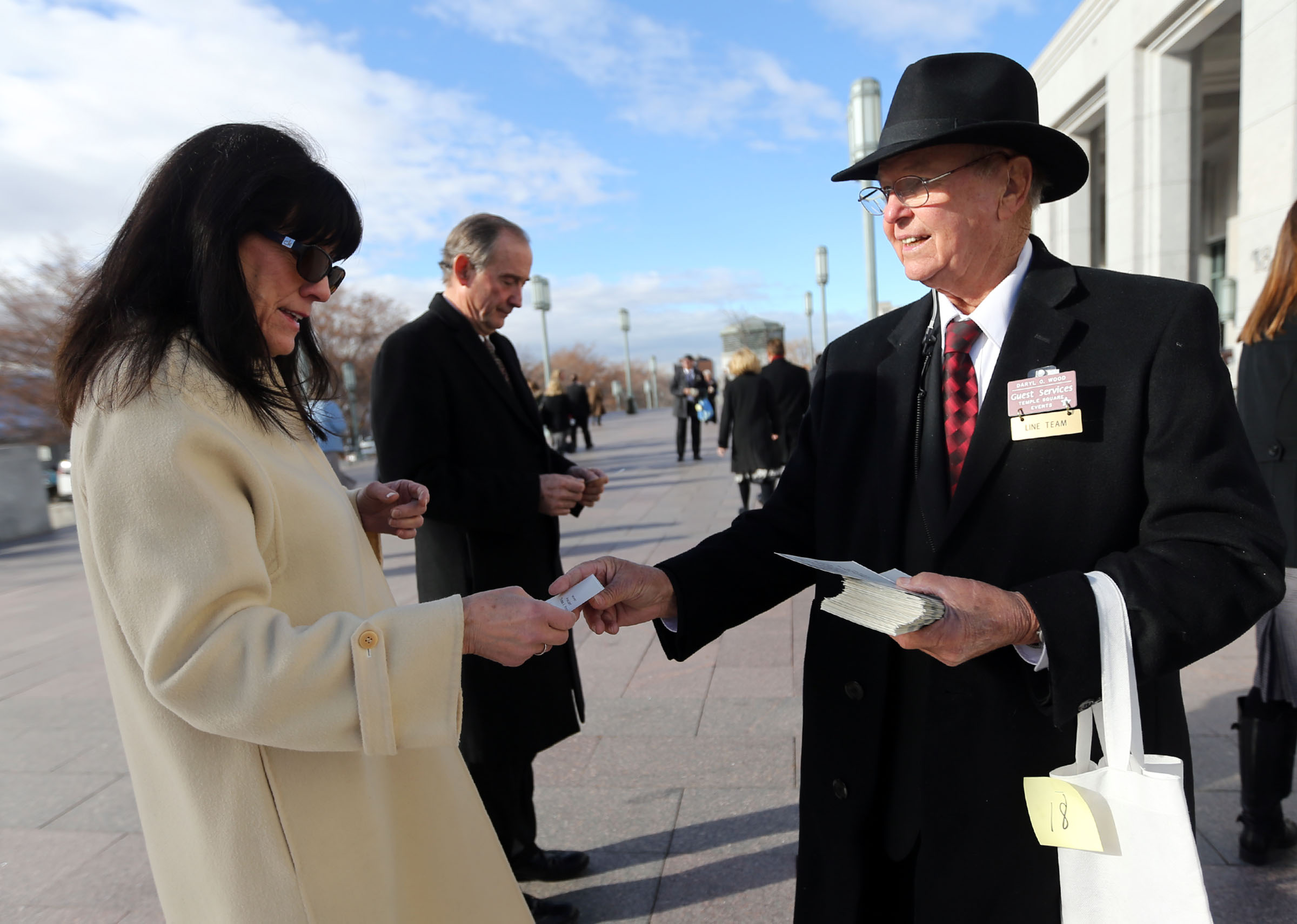 Lynn Winkler gets a ticket from Daryl O. Wood for President Thomas S. Monson's funeral at the Conference Center in Salt Lake City on Friday, Jan. 12, 2018.