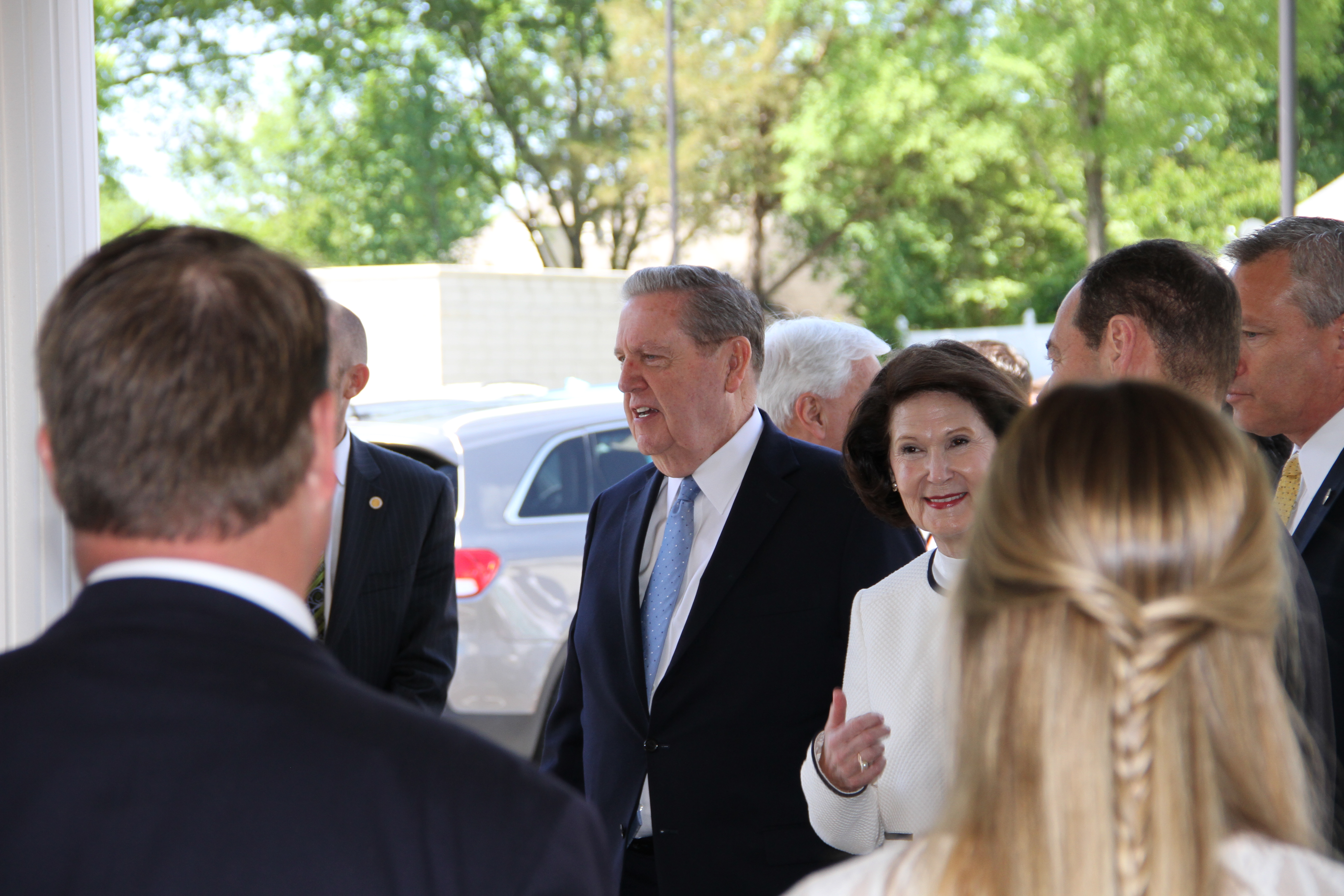 Elder Jeffrey R. Holland and Sister Patricia Holland greet members as they leave the Memphis Tennessee Temple following the rededication ceremony on May 5, 2019.
