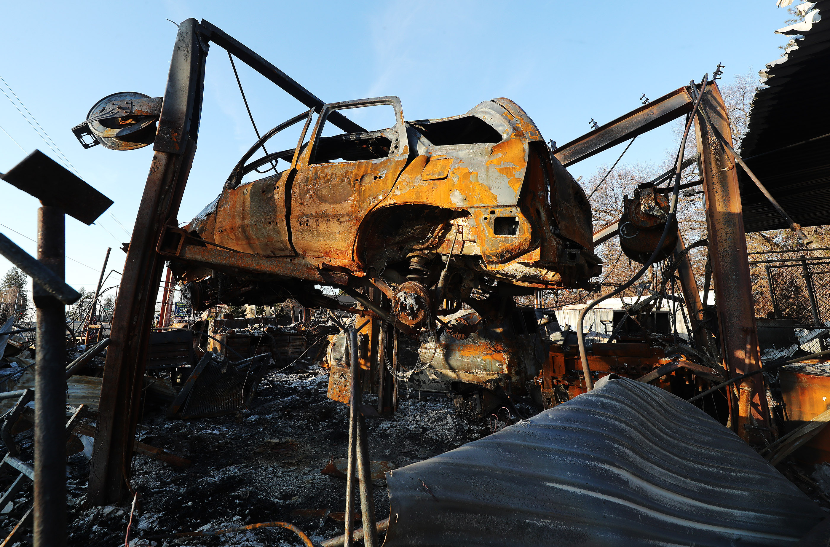 A car on a hoist remains in Paradise, California, on Saturday, Jan. 12, 2019, two months after the Camp Fire destroyed more than 18,000 homes and businesses.