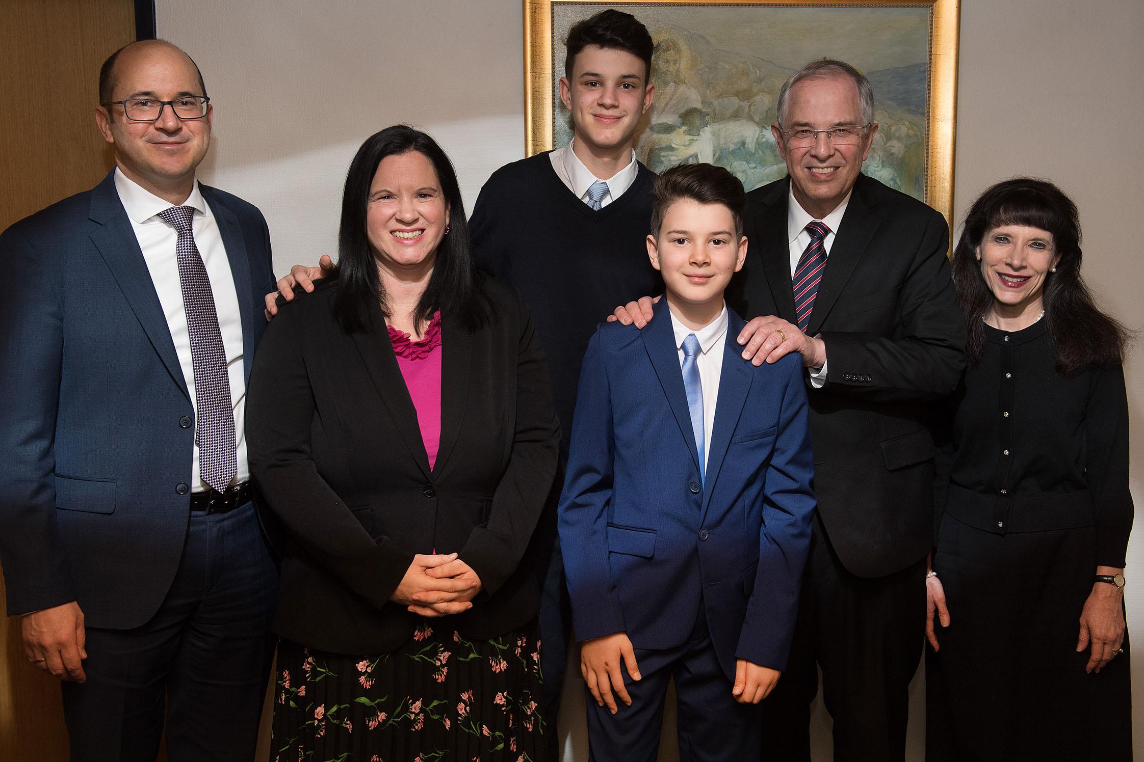 Elder Neil L. Andersen and Sister Kathy Andersen with Elder Helmut and Sister Julia Wondra and their sons, Samuel and Benjamin.