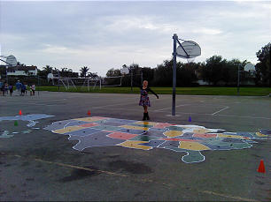 Chantal Hales poses on the map she helped restore, at Marblehead Elementary in San Clemente, Calif.