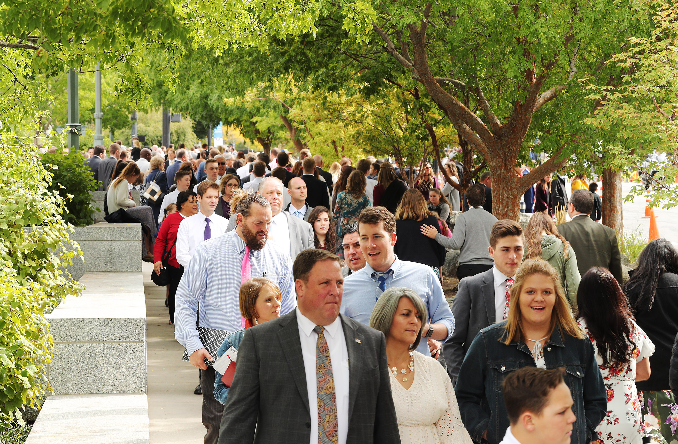 Attendees leave the morning session during the 188th Semiannual General Conference of The Church of Jesus Christ of Latter-day Saints in Salt Lake City on Saturday, Oct. 6, 2018.