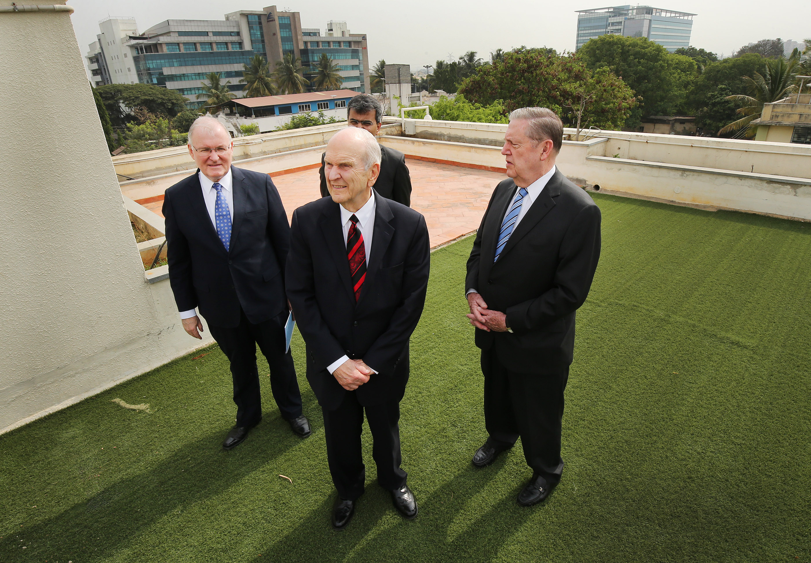 Elder Randy D. Funk, General Authority Seventy; President Russell M. Nelson; Elder Jeffrey R. Holland of the Quorum of the Twelve Apostles; and Elder Robert K. William, an Area Seventy, look over a possible temple site in Bengaluru, India, on Thursday, April 19, 2018.
