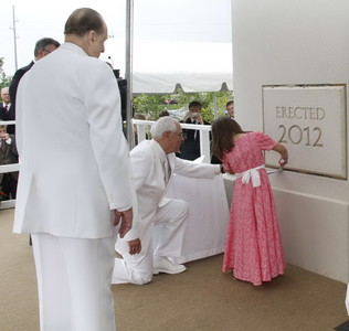 President Thomas S. Monson Watches as Elder William R. Walker of the Seventy assists Sydney Bond in placing mortar in the cornerstone ceremony at Kansas City Missouri Temple dedication.