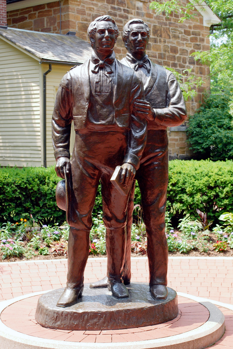 A statue of Joseph and Hyrum Smith stands by Carthage Jail in Illinois.
