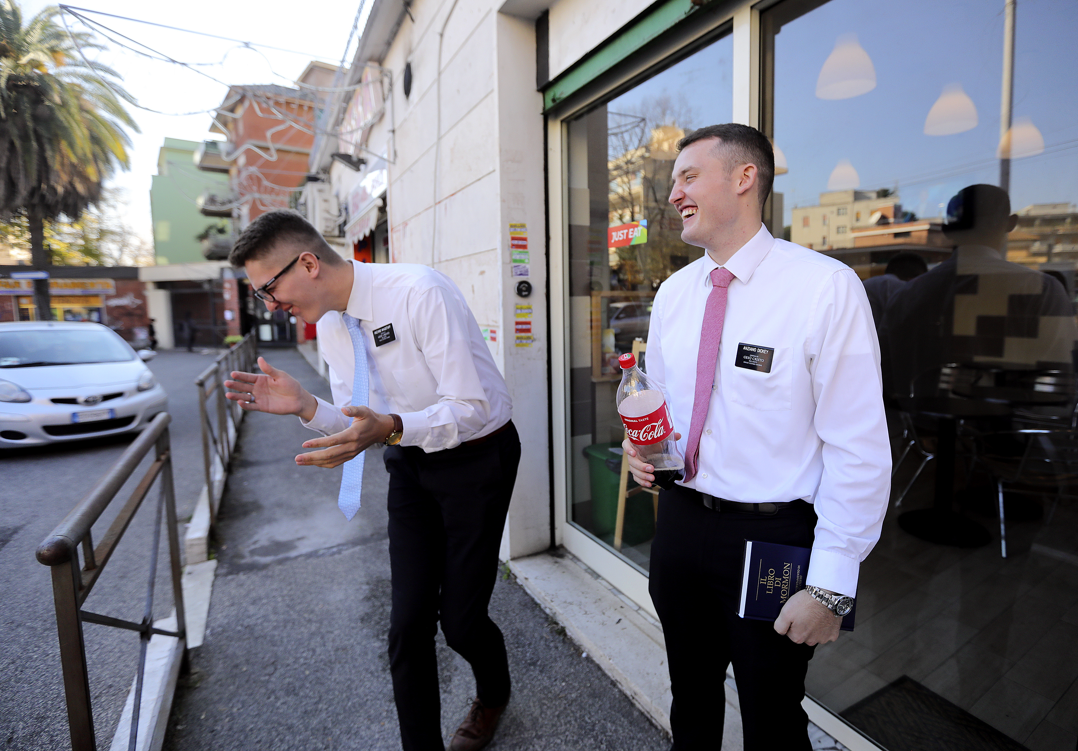 Elder Travis Wagstaff and Elder Bryce Dickey laugh after finishing lunch in Rome, Italy, on Saturday, Nov. 17, 2018.