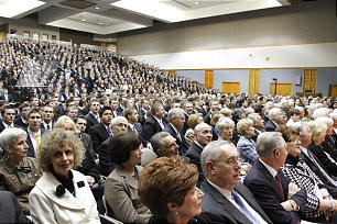 Missionaries gather for a devotional in the Missionary Training Center where Elder Russell M. Nelson of the Quorum of the Twelve enlisted the scriptures to speak concerning the gathering of Israel. In attendance were also those called to serve in various visitors' centers.