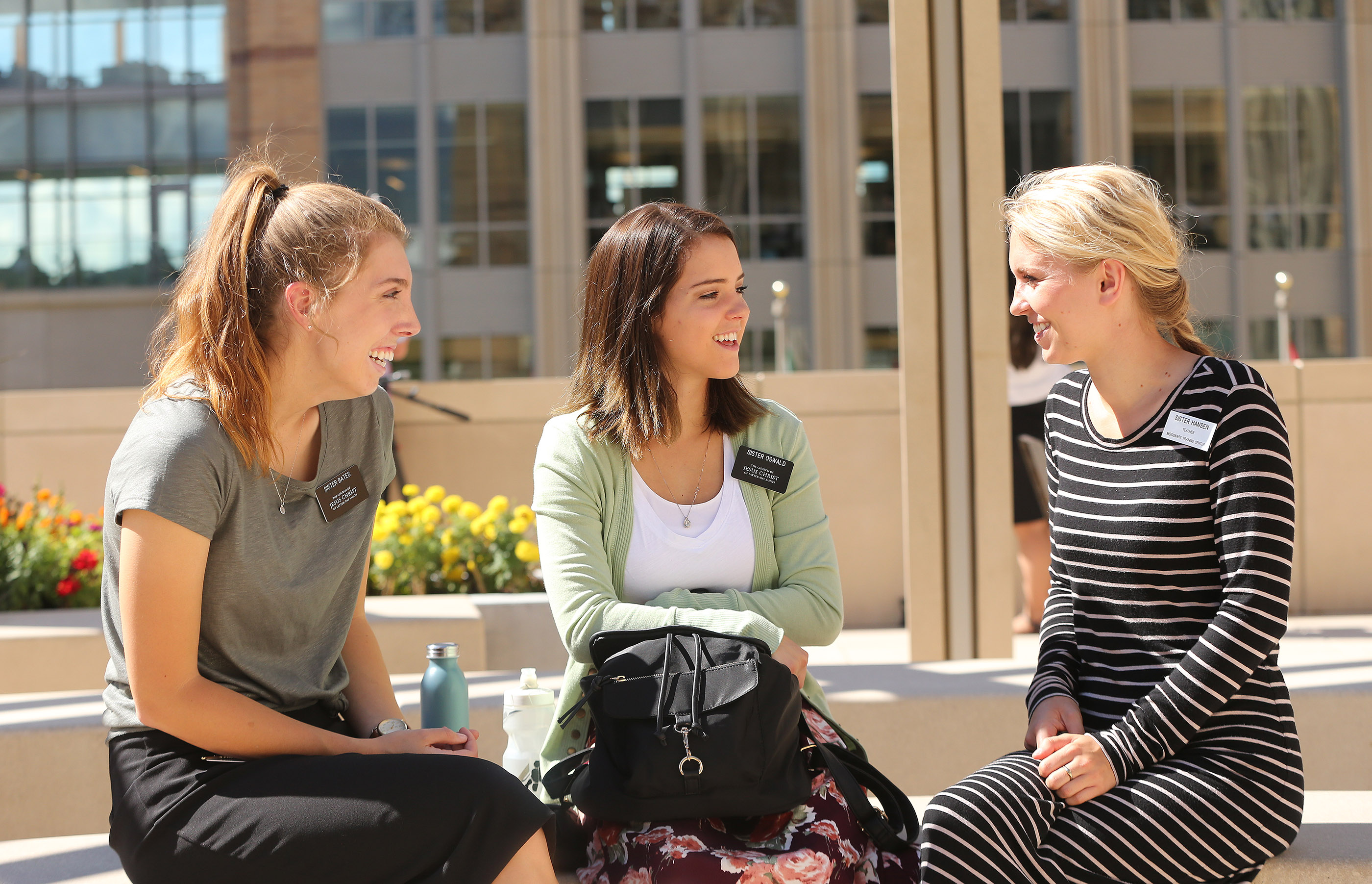 Sisters Hannah Bates and Abigail Oswald talk with their teacher Lexi Hansen in the open spaces between the new T3 and T4 training buildings at the Provo Missionary Training Center in Provo on Wednesday, July 26, 2017.
