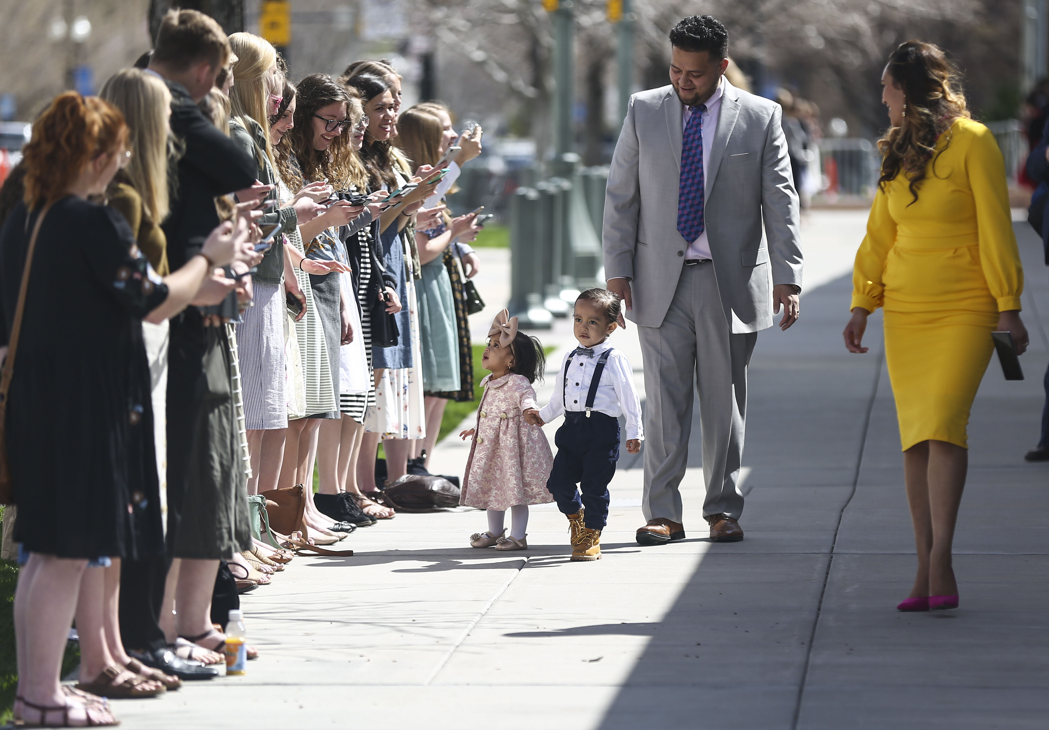 Conferencegoers sing outside the Conference Center while attendees leave after the Sunday morning session of the 189th Annual General Conference of the Church of Jesus Christ of Latter-day Saints in Salt Lake City on Sunday, April 7, 2019.