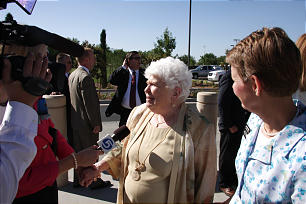 Olive Beth Mack, daughter of President Spencer W. Kimball, is interviewed by the media between dedicatory sessions of The Gila Valley temple. President Kimball lived many years here and spoke endearingly of this valley in southeastern Arizona.