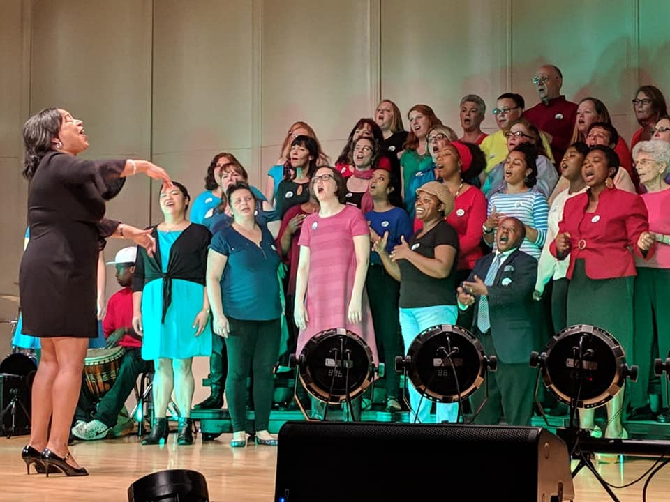 The Tacoma Refugee Choir sings on stage during one of their performances.
