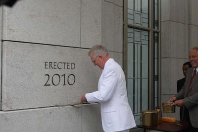 Elder D. Todd Christofferson of the Twelve applies mortar to Vancouver British Columbia Temple cornerstone.