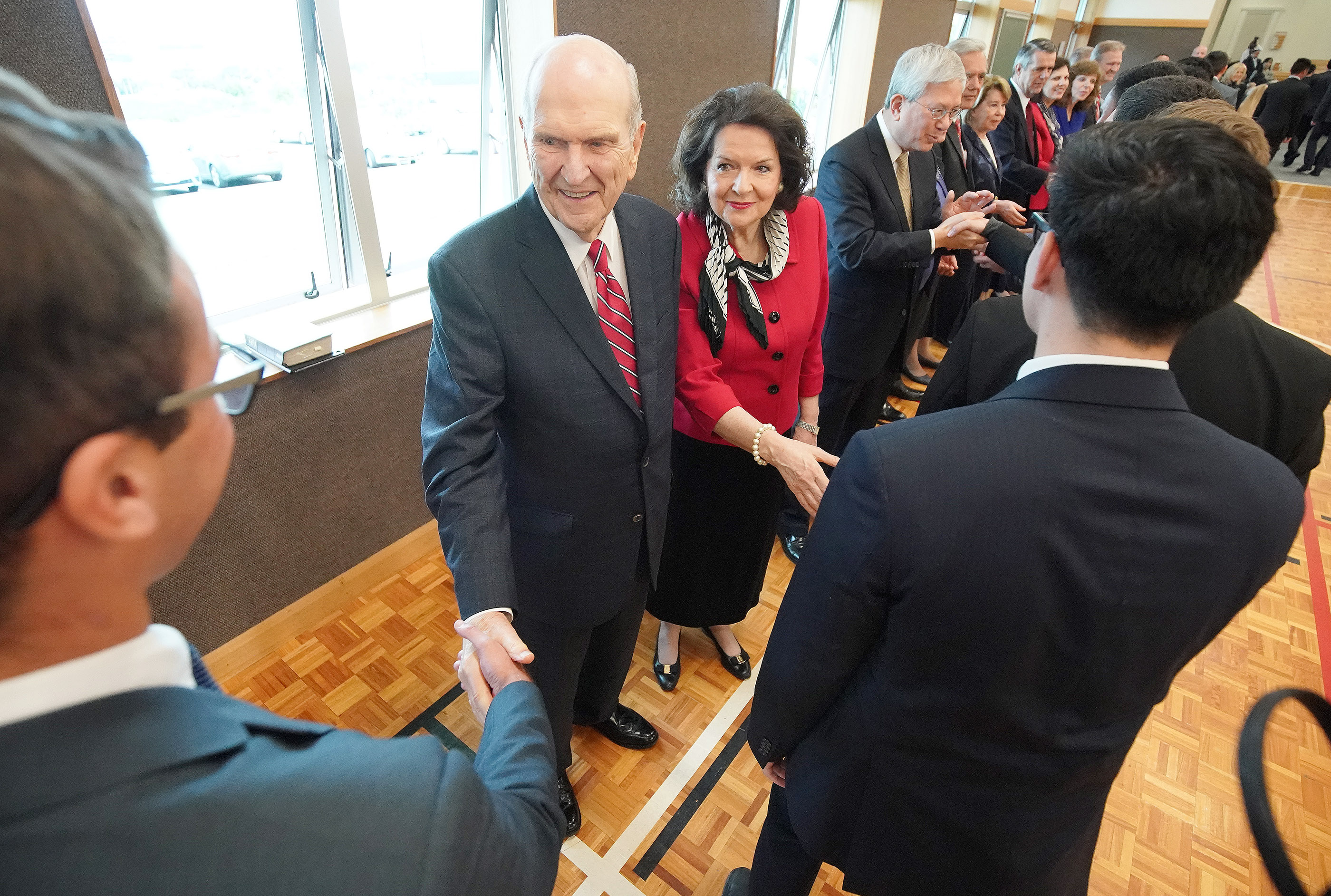 President Russell M. Nelson of The Church of Jesus Christ of Latter-day Saints and his wife, Sister Wendy Nelson, greet missionaries in Auckland, New Zealand, on Tuesday, May 21, 2019.