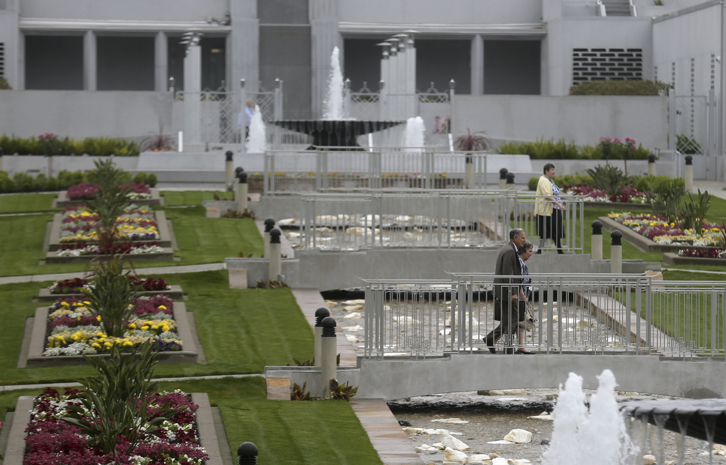 People walk on the grounds of the newly renovated Oakland California Temple, of The Church of Jesus Christ of Latter-day Saints, in Oakland, Calif., on Monday, May 6, 2019.