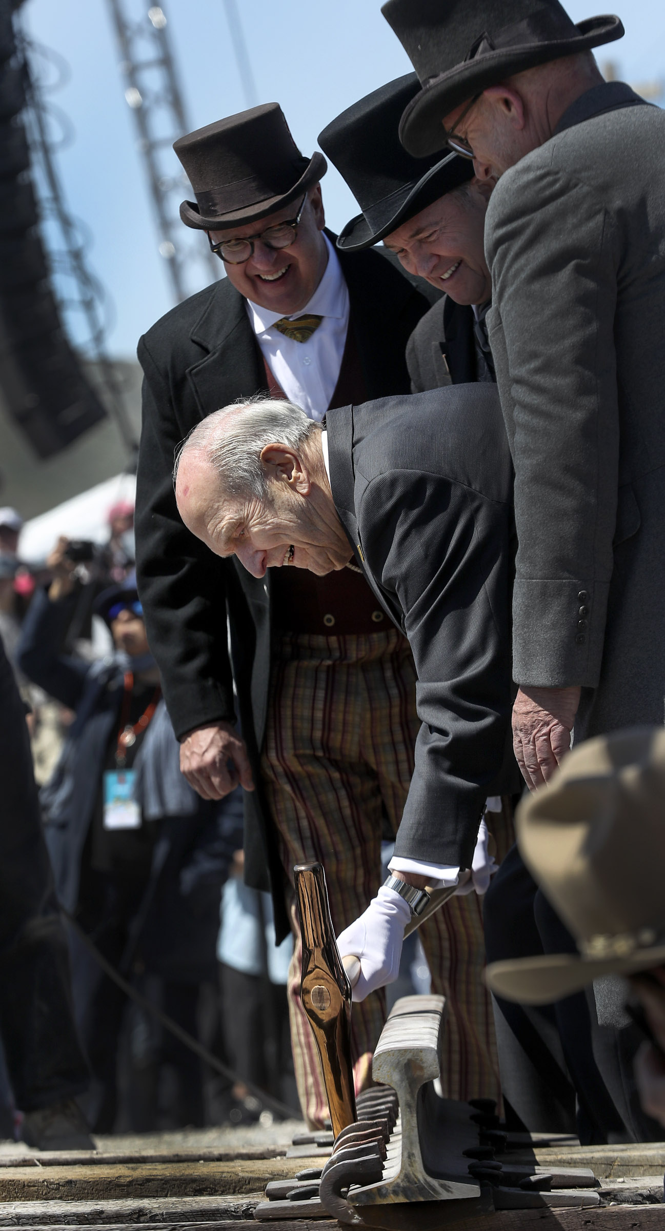 President Russell M. Nelson of The Church of Jesus Christ of Latter-day Saints, center, drives a ceremonial spike during the Golden Spike Sesquicentennial Celebration and Festival at Promontory Summit, Utah, on Friday, May 10, 2019.
