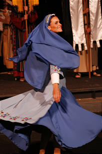 Actress portraying Mary, the mother of Jesus, dancing.