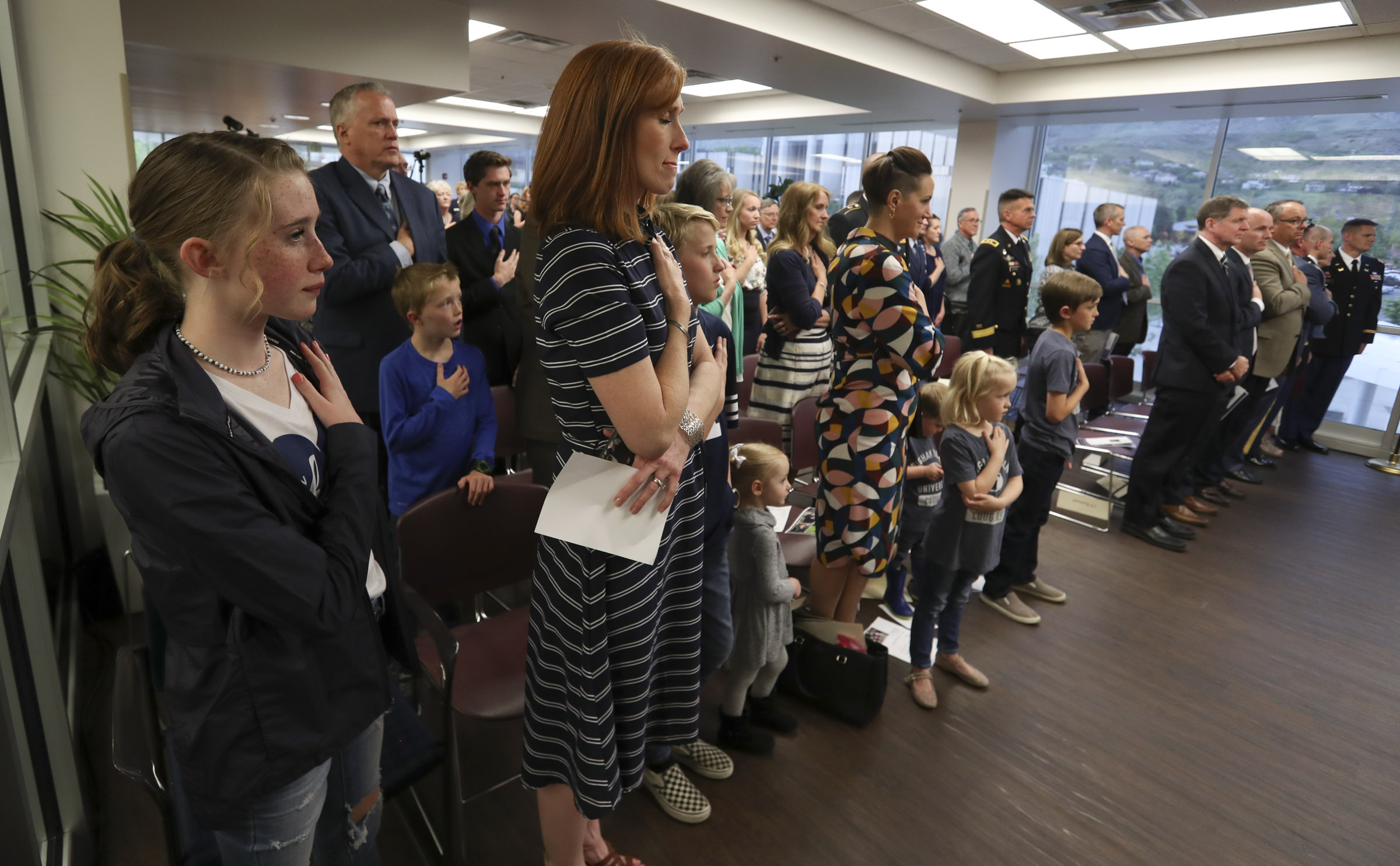 Jennie Taylor stands with her children during a ceremony where the name of her husband, Maj. Brent Taylor, was added to the Reflection Room Memorial Wall in the Wilkinson Center on the BYU campus in Provo on Thursday, May 23, 2019. Taylor was killed in Afghanistan in 2018.