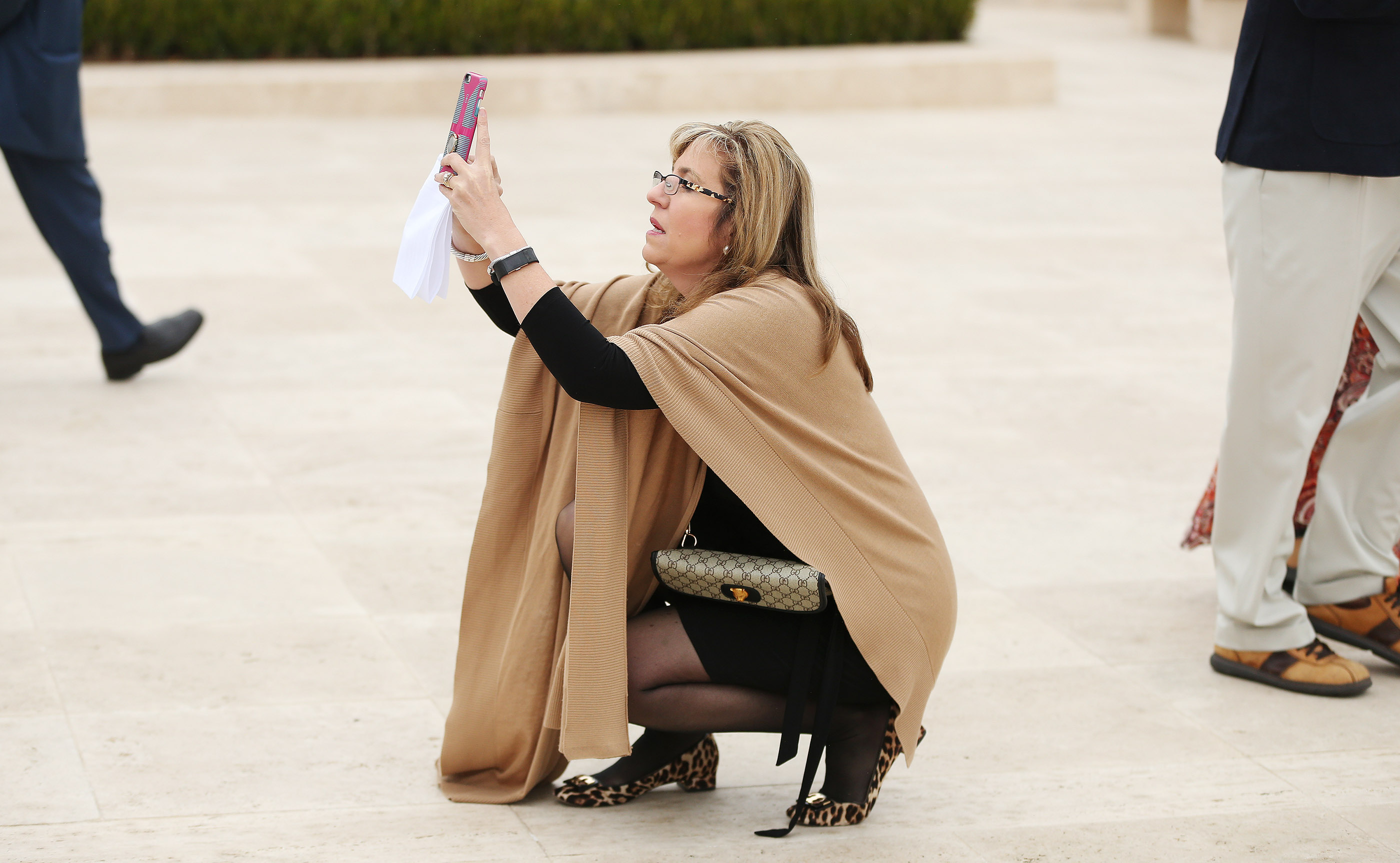 Daniella Piner shoots a photo outside of the Rome Italy Temple of The Church of Jesus Christ of Latter-day Saints during its dedication on Sunday, March 10, 2019.