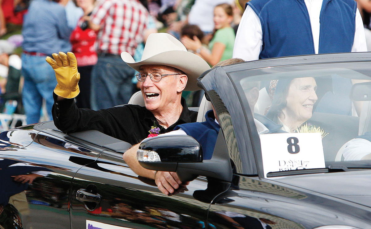 President Henry B. Eyring waves to the crowd during the Days of '47 parade Tuesday, July 24, 2012, in Salt Lake City, Utah.