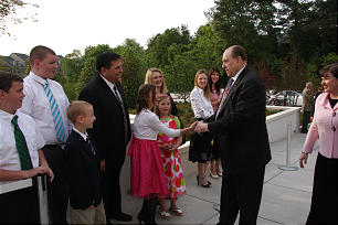 Upon arriving for the rededication of the Atlanta Georgia Temple on Sunday, May 1, President Thomas S. Monson greets Lauren Kelly, 11, and other members of the Philip and Shannon Kelly family.