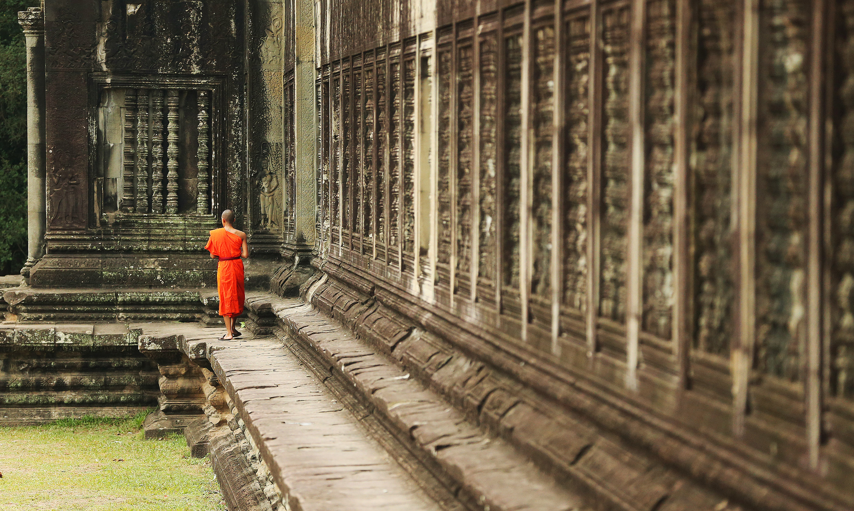 A Buddhist monk walks around Angkor Wat in Cambodia on April 28, 2018. Angkor Wat is a 12th century temple complex in Cambodia and the largest religious monument in the world.