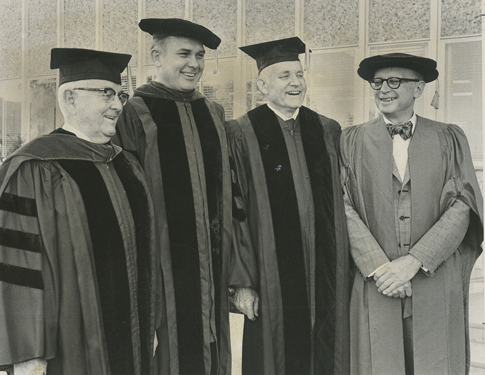 President Spencer W. Kimball, President Dallin Oaks, Elder Howard W. Hunter and Dr. Daniel J. Boorstin chat before BYU Commencement.