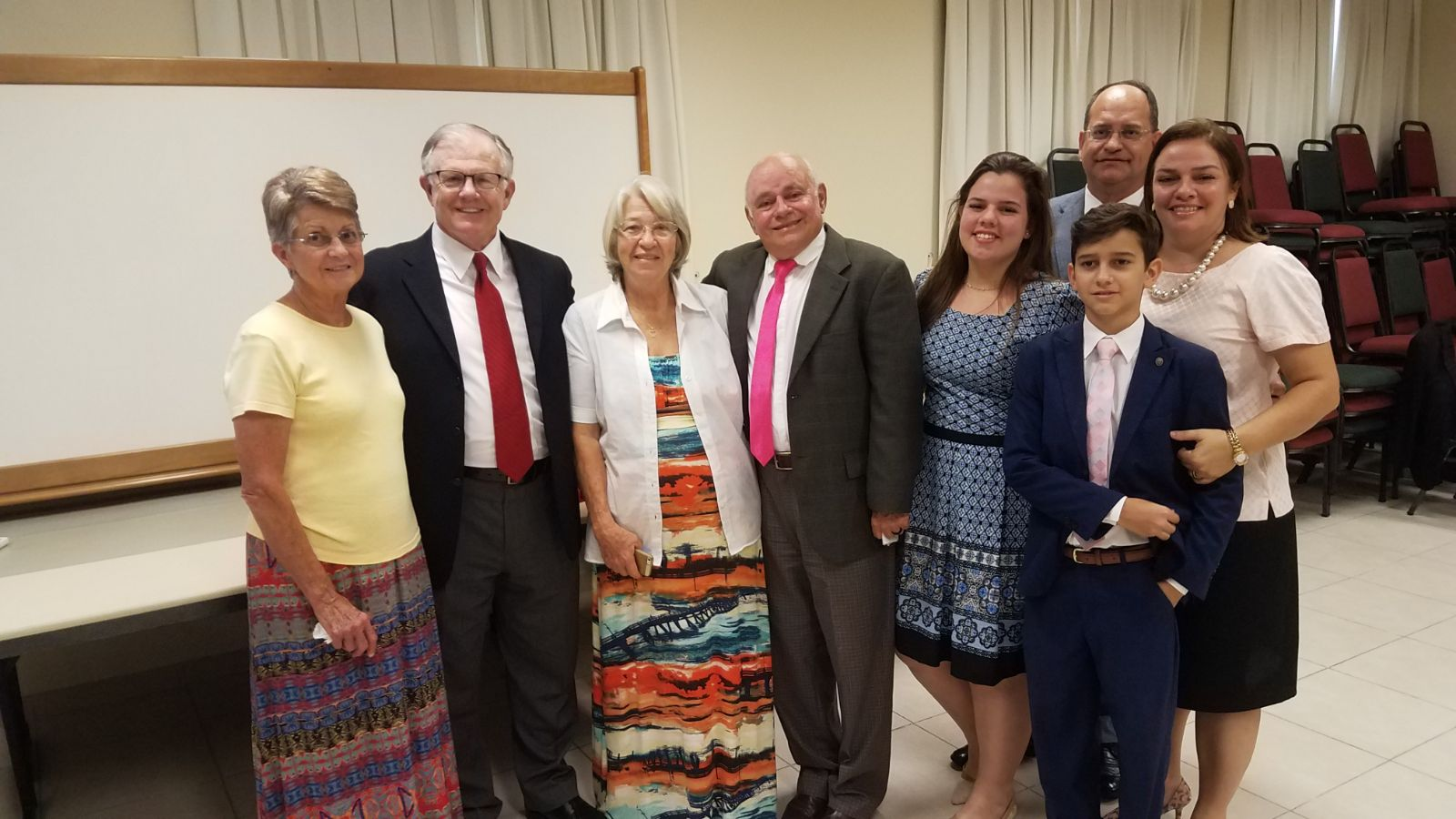 John M. Beck, second from left, and Antonio Ferreira, center, pause for a photo with Beck's wife, Lynette, and Ferreria's wife and family members in Fortaleza, Brazil, on June 1, 2019.