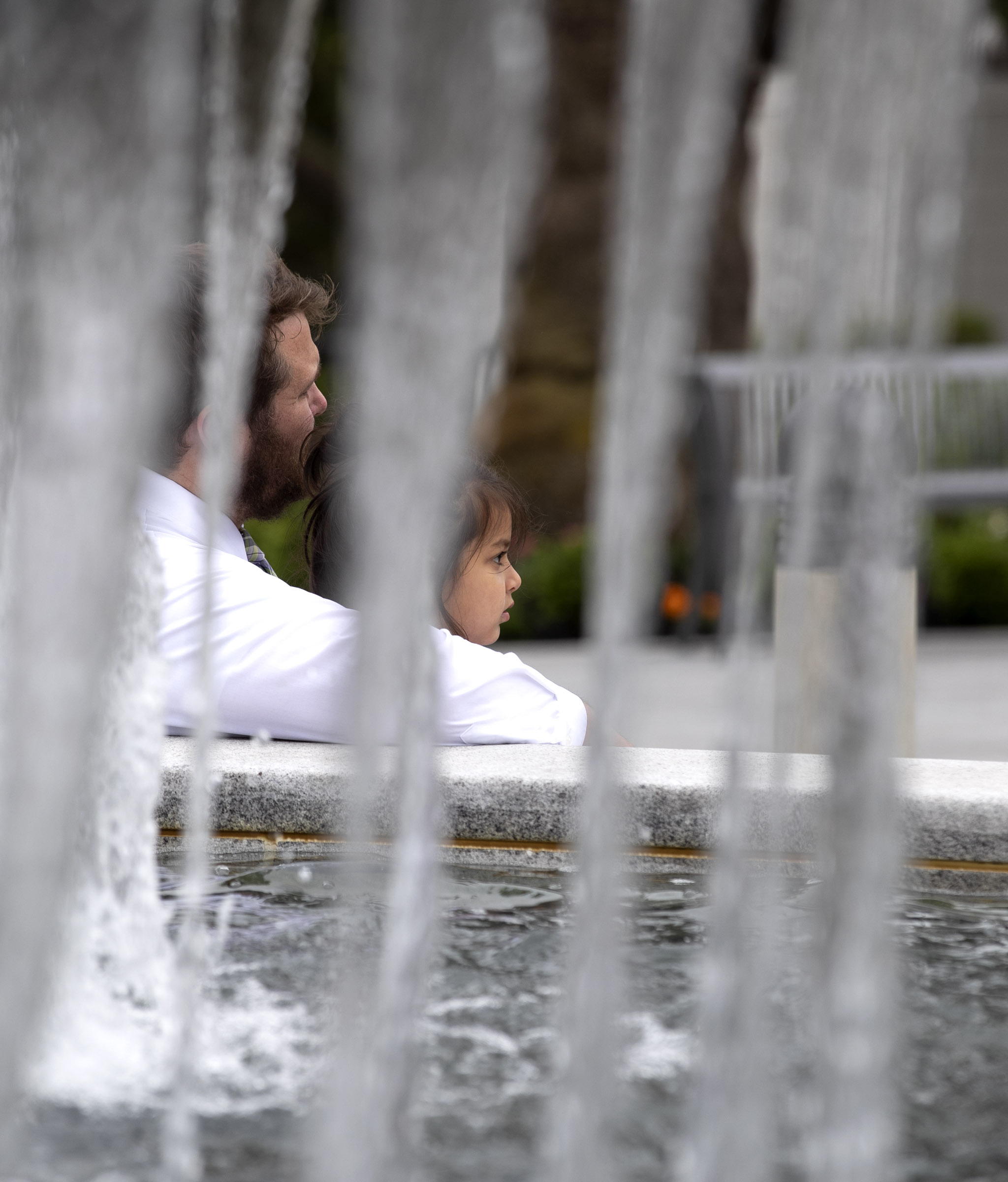 Sabraya Gorham sits by the fountain with her father, Matthew Gorham, as she waits for her mother, Avalika Gorham, to come out of the Oakland California Temple where President Dallin H. Oaks, first counselor in the First Presidency, rededicated the building on Sunday, June 16, 2019.