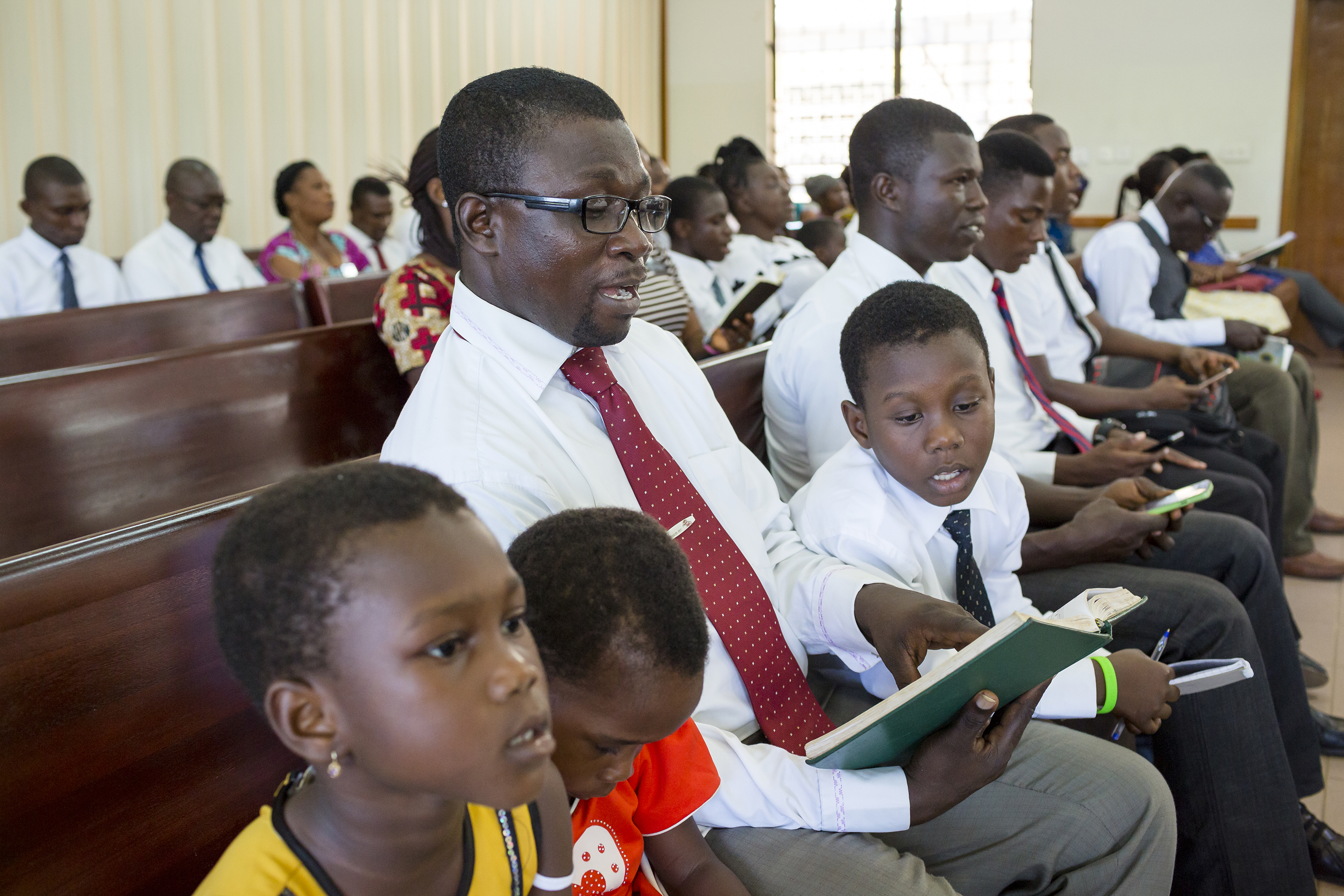 "Church members in Ghana sing from a hymnbook in a worship service. Church leaders announced in June 2018 that they have formed a committee to suggest major revisions to the ""Hymns"" and ""Children's Songbook"" for the first time since it was published in 1985. The new project is not expected to be complete for several years."