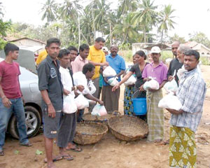 Refugees in Negombo, Sri Lanka, receive relief supplies assembled and distributed by Church members. Local response has been timely.