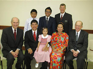 Elder Russell M. Nelson, far left, and other leaders sit with family of district president Benedict S. Ingkon.