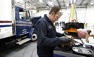 Glen West works on a truck in the vehicle maintenance facility of the new Utah Bishops' Central Storehouse in Salt Lake City, Thursday, Jan. 26, 2012.
