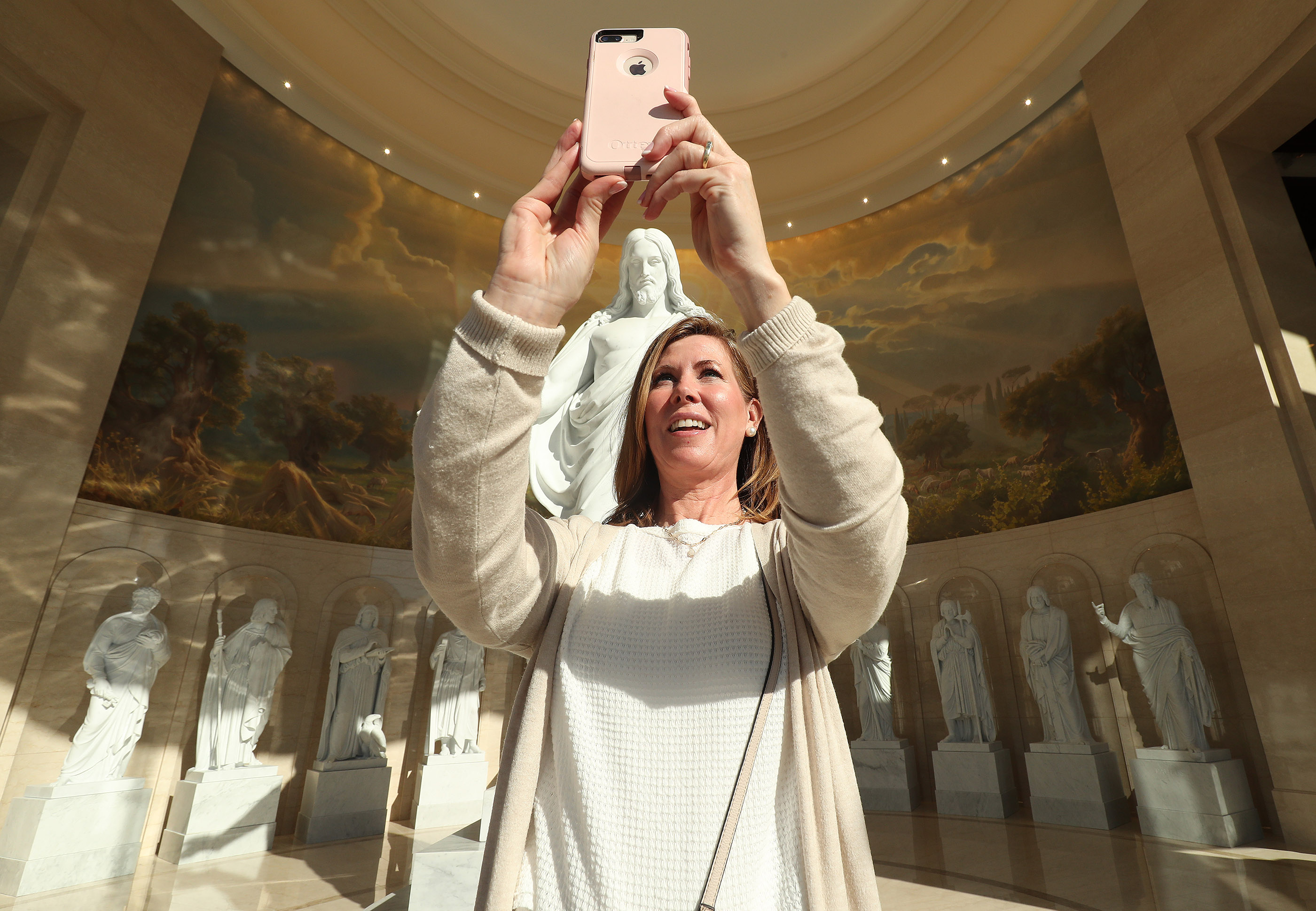 Christie Latham takes a photo in the Rome Italy Temple Visitors' Center in Rome on Tuesday, March 12, 2019.