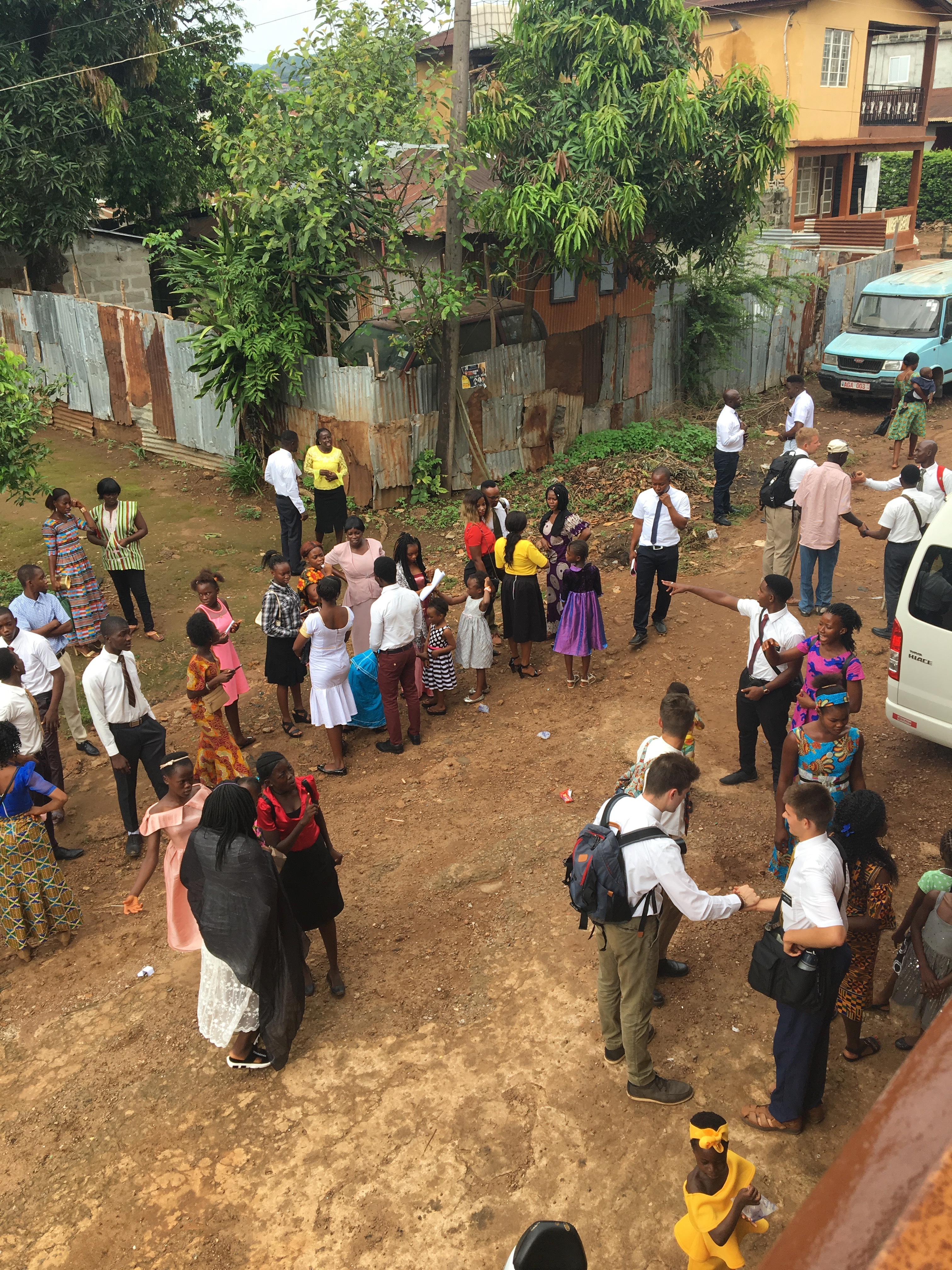 Church members and missionaries gather in the street near a Church meetinghouse in Sierra Leone during a visit from Sister Jean B. Bingham to observe the implementation of the Gospel Literacy program.