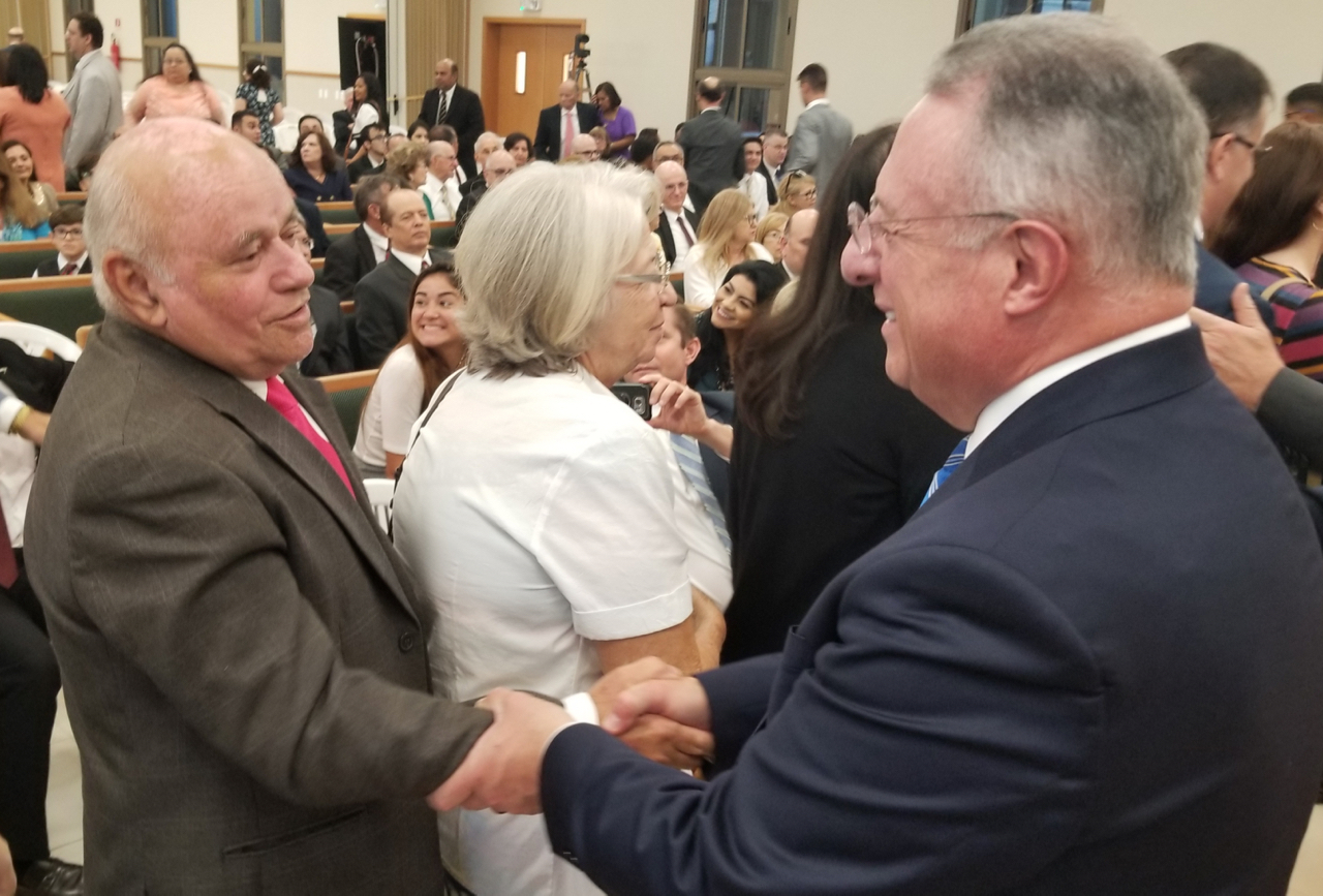 Elder Ulisses Soares of the Quorum of the Twelve Apostles, right, greets Antonio Ferreria following a meeting with visiting Church leaders and the pioneer members of Fortaleza, Brazil, on June 1, 2019.