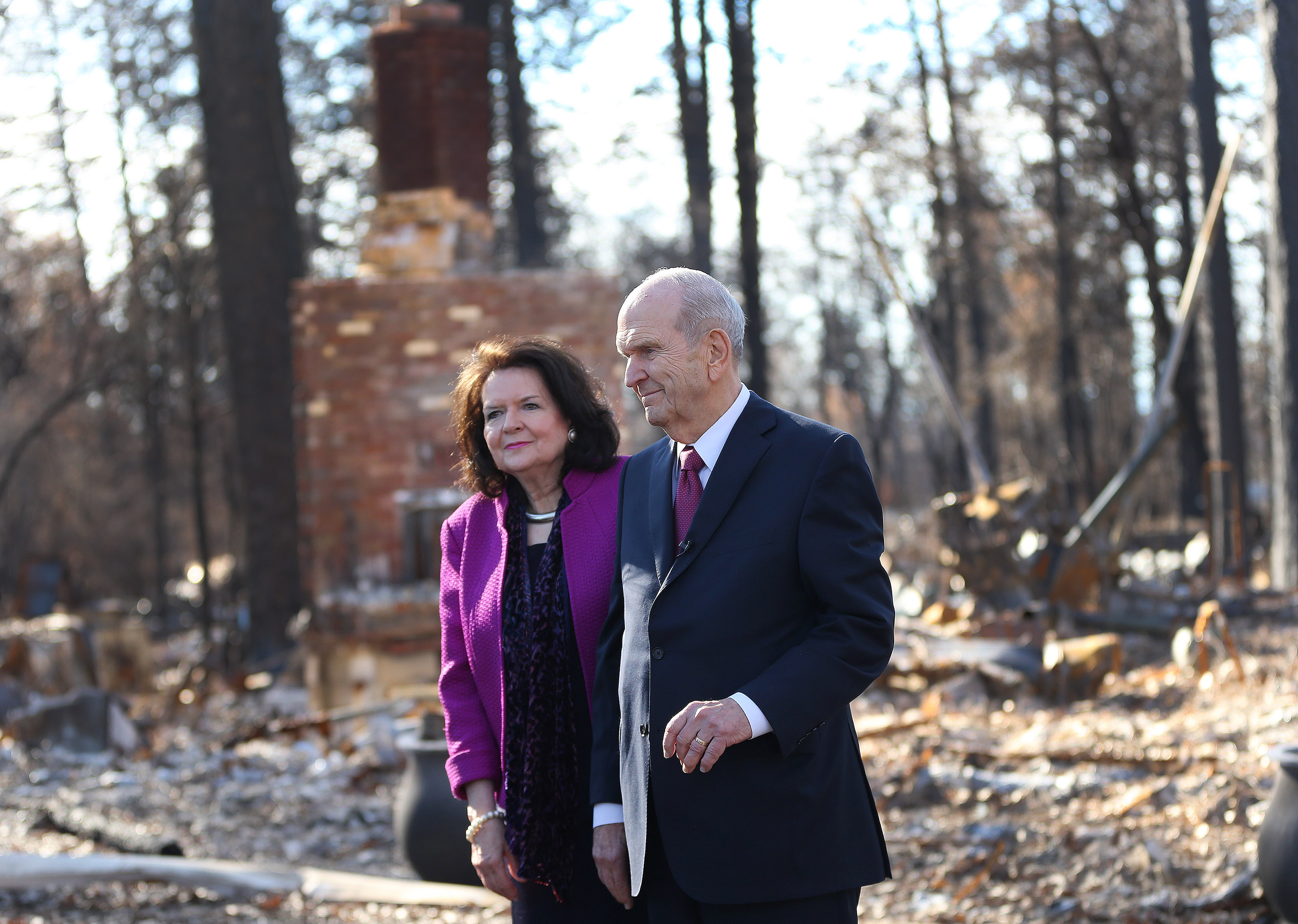 President Russell M. Nelson of The Church of Jesus Christ of Latter-day Saints looks over destroyed homes with his wife, Sister Wendy Nelson, in Paradise, California, on Sunday, Jan. 13, 2019, two months after the Camp Fire destroyed 1,400 homes and hundreds of businesses.