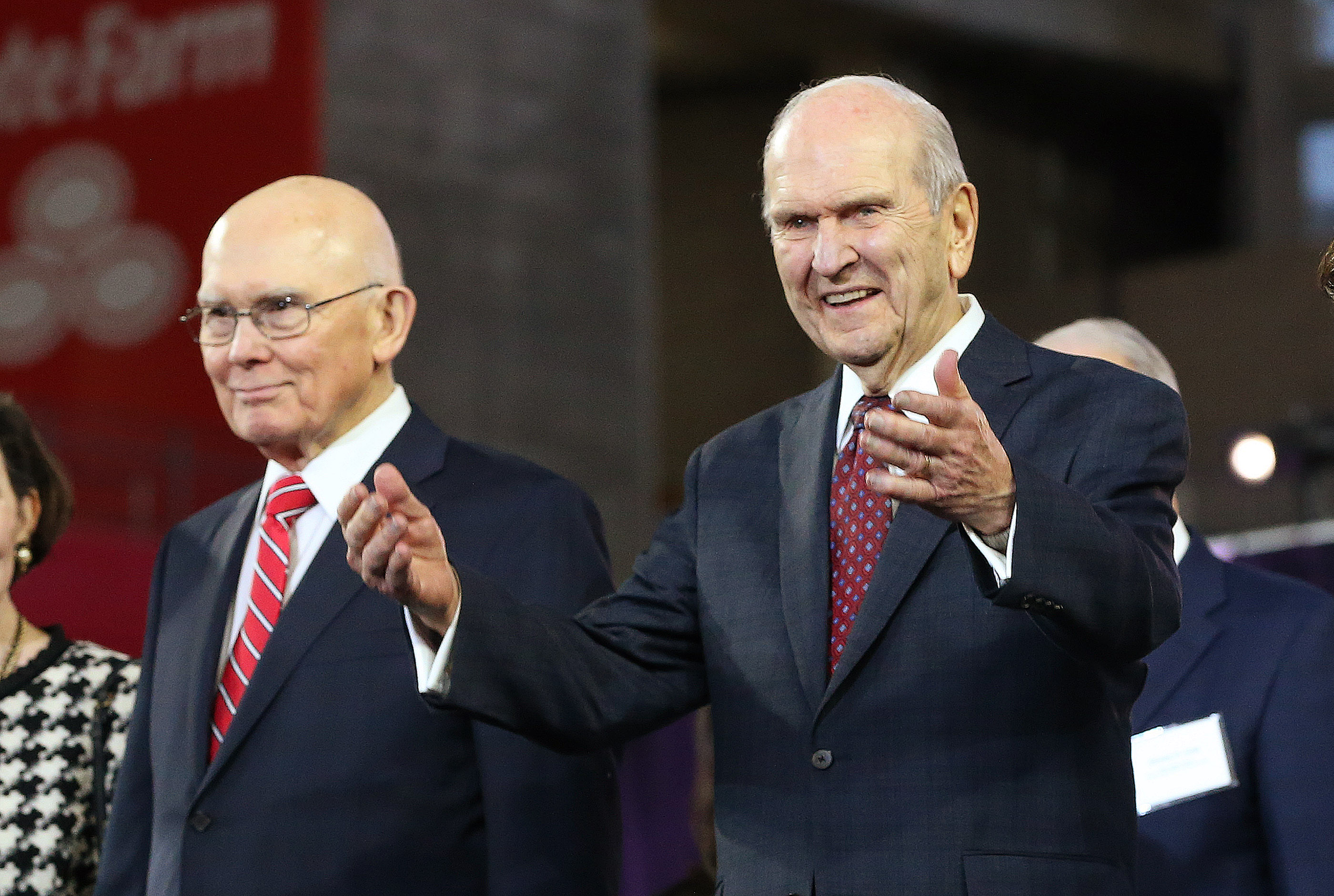 President Russell M. Nelson of The Church of Jesus Christ of Latter-day Saints gestures to attendees at the State Farm Stadium in Phoenix on Sunday, Feb. 10, 2019. Nelson is accompanied by President Dallin H. Oaks, first counselor.