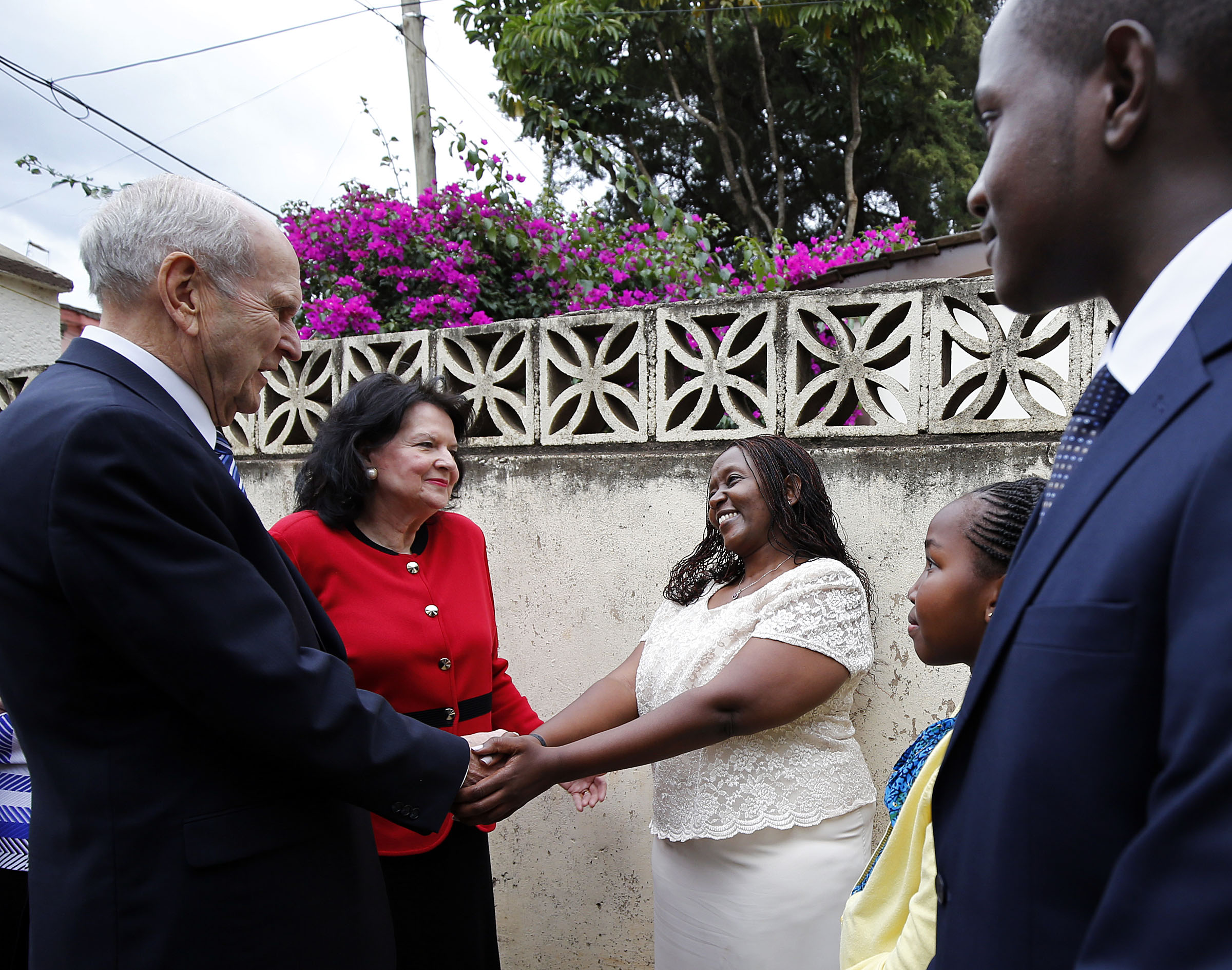 President Russell M. Nelson and Sister Wendy Nelson greet Mercy Makau, her daughter Gloria Nashipai, and her son William Mbogo at the home of Makau's aunt in Nairobi, Kenya, on Monday, April 16, 2018.