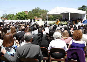 Elder Neil L. Andersen addresses some 500 members gathered under sunny skies for the dedication of the Cordoba Argentina Temple site.