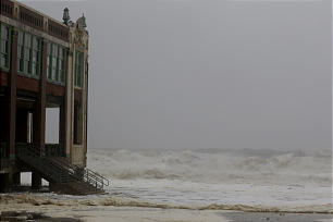 Large waves move up toward a building on the boardwalk in Asbury Park, N.J., as Hurricane Sandy moves closer to the Jersey Shore, Monday, Oct. 29, 2012.